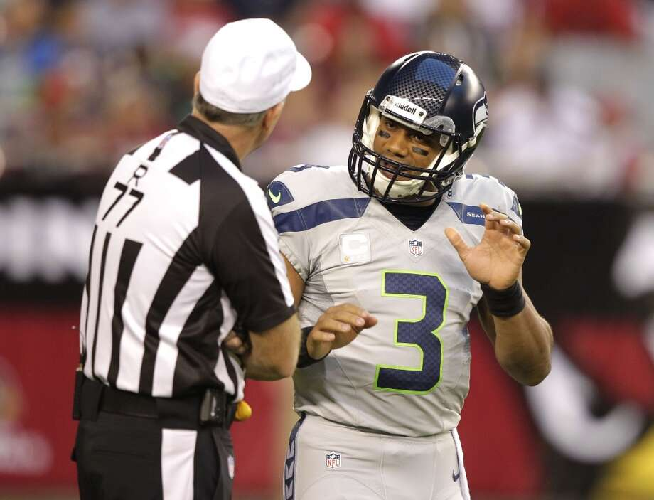 Seattle Seahawks quarterback Russell Wilson (3) talks with referee Terry McAulay (77) (77) during the first half of an NFL football game against the Arizona Cardinals, Thursday, Oct. 17, 2013, in Glendale, Ariz. (AP Photo/Rick Scuteri) Photo: AP