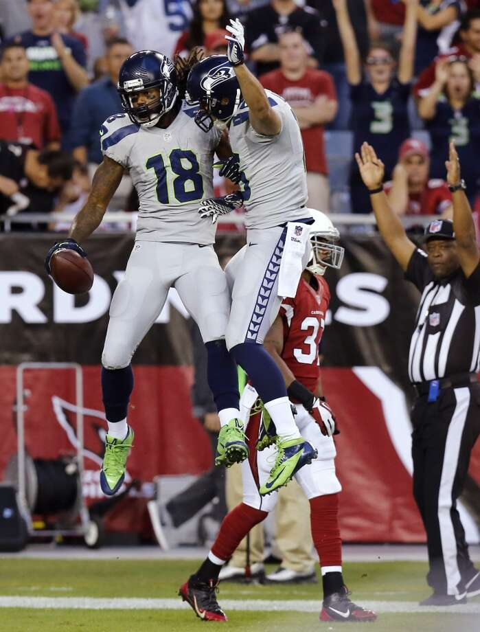 Seattle Seahawks wide receiver Sidney Rice (18) celebrates his touchdown with Jermaine Kearse, right, as Arizona Cardinals strong safety Yeremiah Bell, rear, walks away during the first half of an NFL football game, Thursday, Oct. 17, 2013, in Glendale, Ariz. (AP Photo/Ross D. Franklin) Photo: ASSOCIATED PRESS