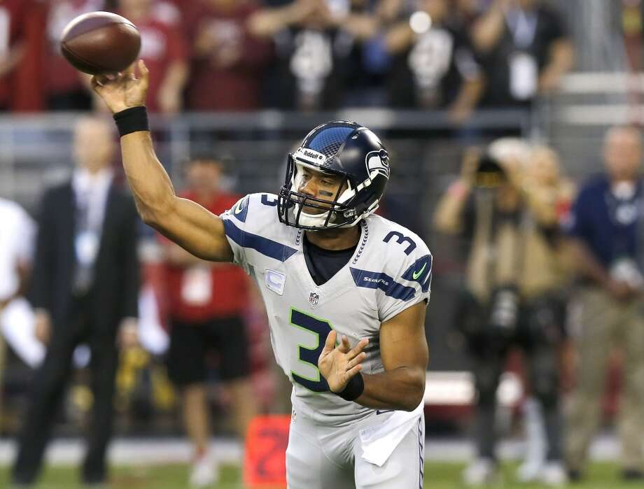 Seattle Seahawks quarterback Russell Wilson (3) throws against the Arizona Cardinals during the first half of an NFL football game, Thursday, Oct. 17, 2013, in Glendale, Ariz. (AP Photo/Ross D. Franklin) Photo: AP