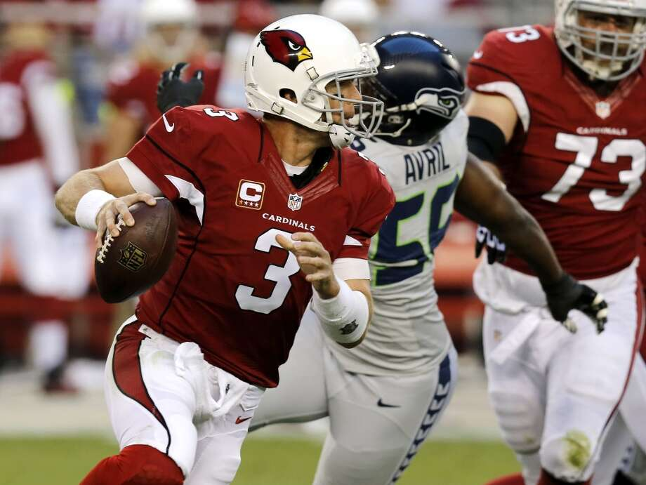 Arizona Cardinals quarterback Carson Palmer (3) scrambles under pressure from Seattle Seahawks defensive end Cliff Avril (56) during the first half of an NFL football game, Thursday, Oct. 17, 2013, in Glendale, Ariz. (AP Photo/Ross D. Franklin) Photo: AP