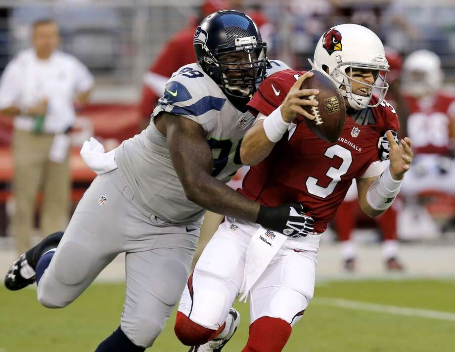Arizona Cardinals quarterback Carson Palmer (3) is sacked by Seattle Seahawks defensive tackle Tony McDaniel (99) during the first half of an NFL football game, Thursday, Oct. 17, 2013, in Glendale, Ariz. (AP Photo/Ross D. Franklin) Photo: ASSOCIATED PRESS