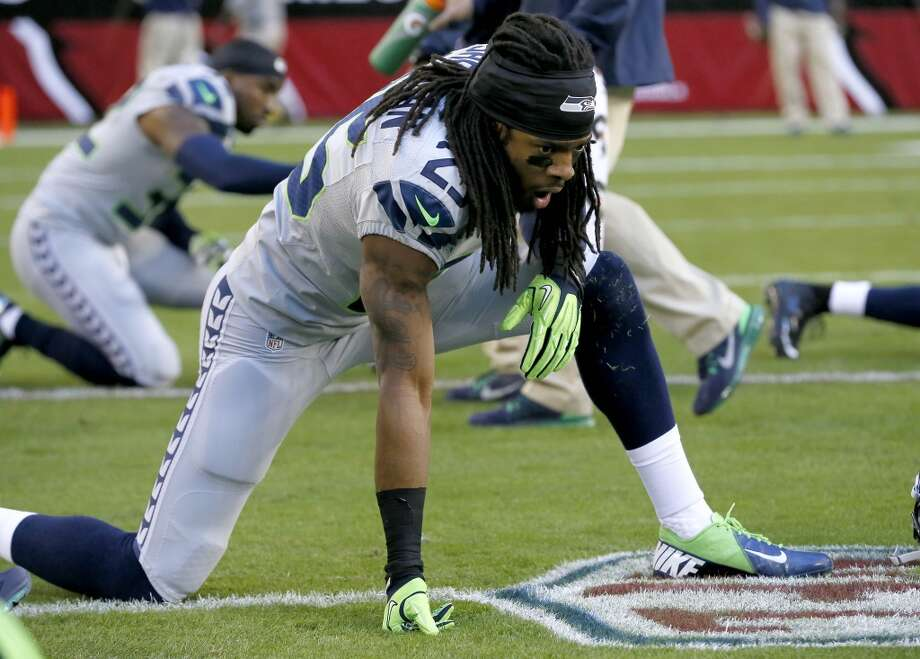 Seattle Seahawks cornerback Richard Sherman (25) stretches prior to a NFL football game against the Arizona Cardinals, Thursday, Oct. 17, 2013, in Glendale, Ariz. (AP Photo/Ross D. Franklin) Photo: AP