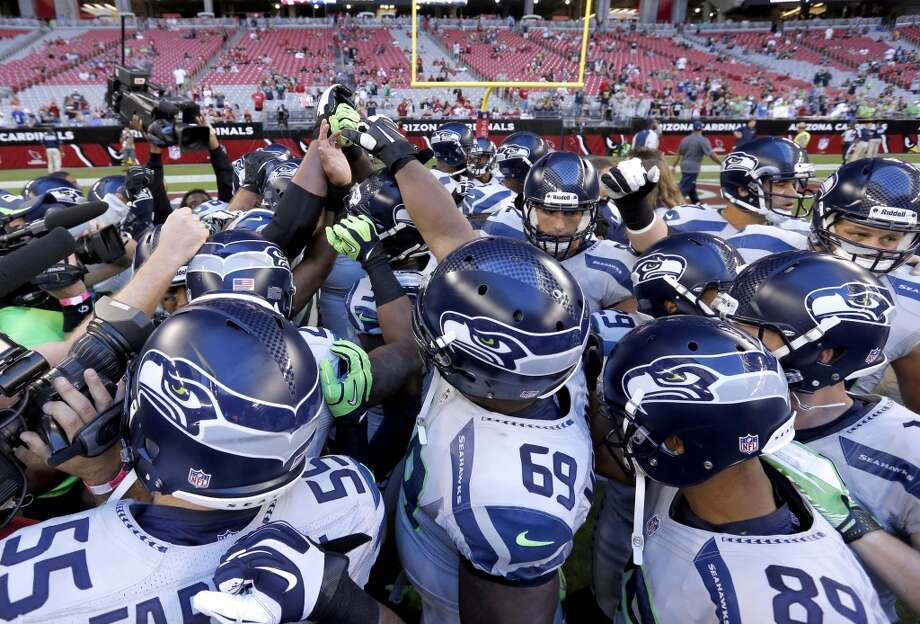 The Seattle Seahawks huddle up prior to a NFL football game against the Arizona Cardinals, Thursday, Oct. 17, 2013, in Glendale, Ariz. (AP Photo/Ross D. Franklin) Photo: AP