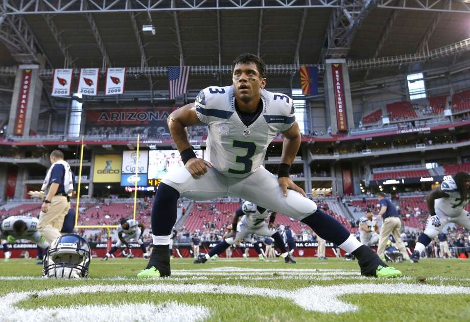 Seattle Seahawks quarterback Russell Wilson (3) stretches prior to a NFL football game against the Arizona Cardinals, Thursday, Oct. 17, 2013, in Glendale, Ariz. (AP Photo/Ross D. Franklin) Photo: AP