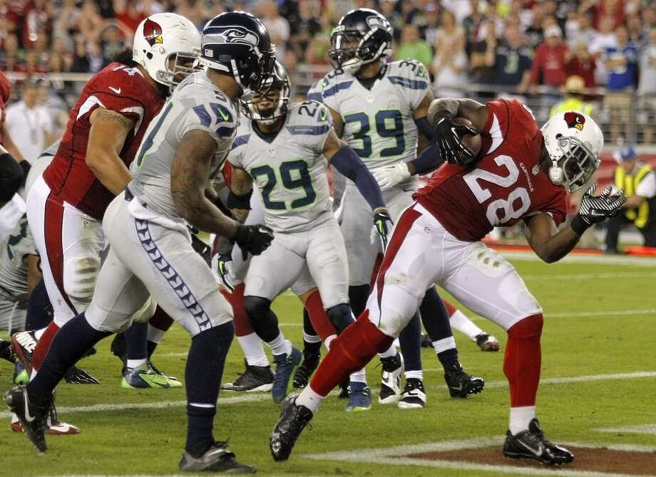 Arizona Cardinals running back Rashard Mendenhall (28) scores a touchdown against the Seattle Seahawks during the first half of an NFL football game, Thursday, Oct. 17, 2013, in Glendale, Ariz. (AP Photo/Rick Scuteri) Photo: AP