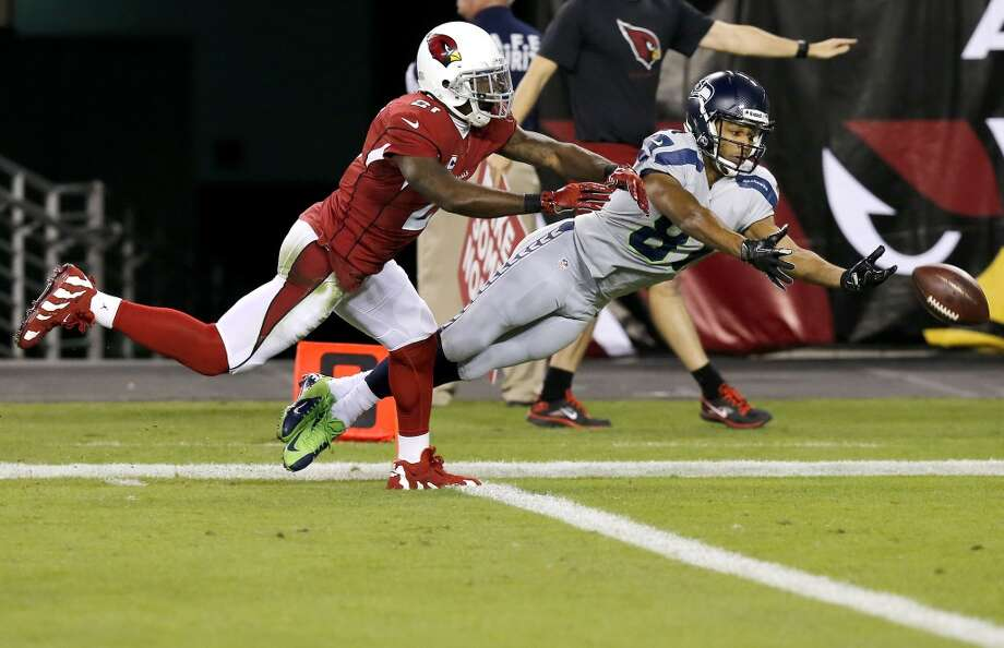 Seattle Seahawks wide receiver Golden Tate, right, can't catch the ball under pressure by Arizona Cardinals cornerback Patrick Peterson (21) during the first half of an NFL football game, Thursday, Oct. 17, 2013, in Glendale, Ariz. (AP Photo/Ross D. Franklin) Photo: AP