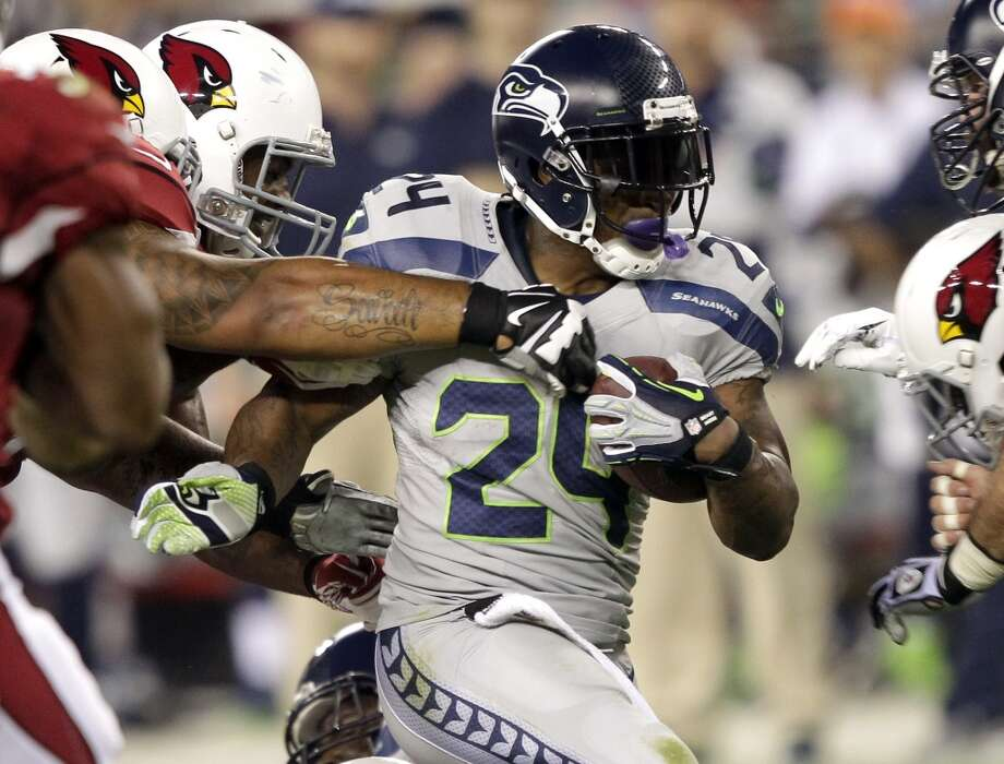 Seattle Seahawks running back Marshawn Lynch (24) runs against the Arizona Cardinals during the first half of an NFL football game, Thursday, Oct. 17, 2013, in Glendale, Ariz. (AP Photo/Rick Scuteri) Photo: ASSOCIATED PRESS