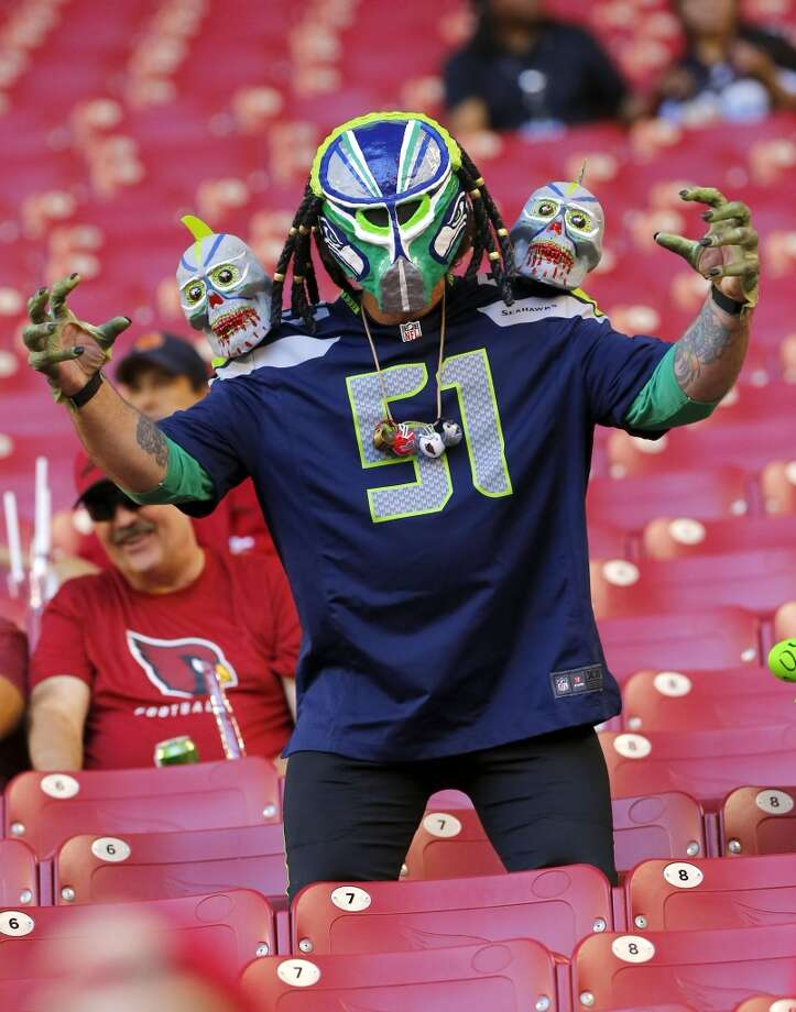 A Seattle Seahawks fan yells to his team prior to a NFL football game against the Arizona Cardinals, Thursday, Oct. 17, 2013, in Glendale, Ariz. (AP Photo/Matt York) Photo: AP