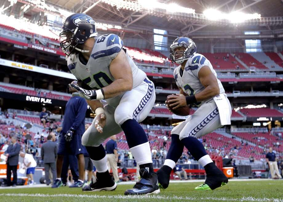 Seattle Seahawks quarterback Russell Wilson (3) takes a snap from Max Unger (60) prior to a NFL football game against the Arizona Cardinals, Thursday, Oct. 17, 2013, in Glendale, Ariz. (AP Photo/Ross D. Franklin) Photo: AP