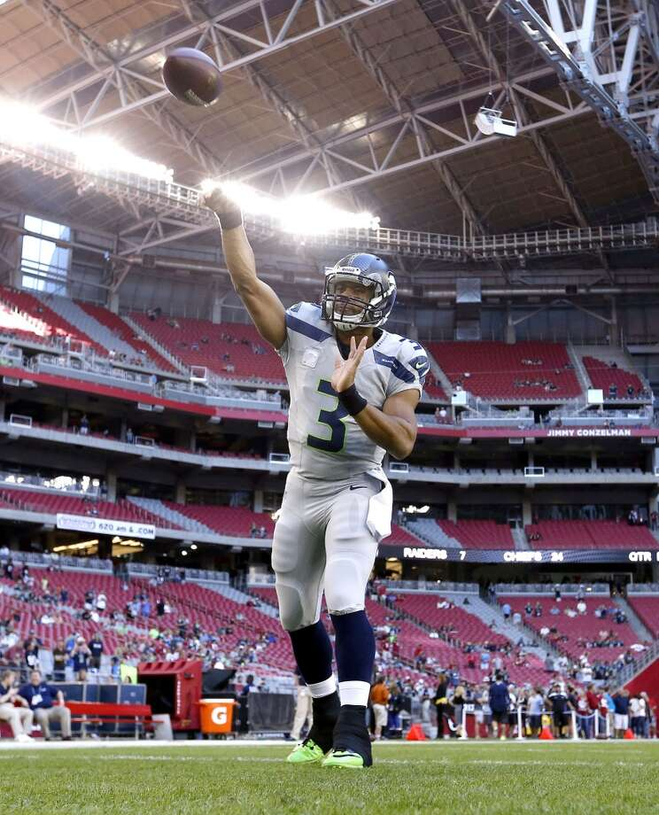 Seattle Seahawks quarterback Russell Wilson warms up for the Seahawks' NFL football game against the Arizona Cardinals, Thursday, Oct. 17, 2013, in Glendale, Ariz. (AP Photo/Ross D. Franklin) Photo: AP