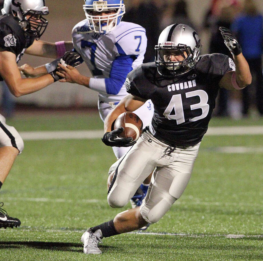 Branden Valle makes a quick cut upfield for the Cougars as Jay plays Clark at Farris Stadium on October 17, 2013. Photo: TOM REEL