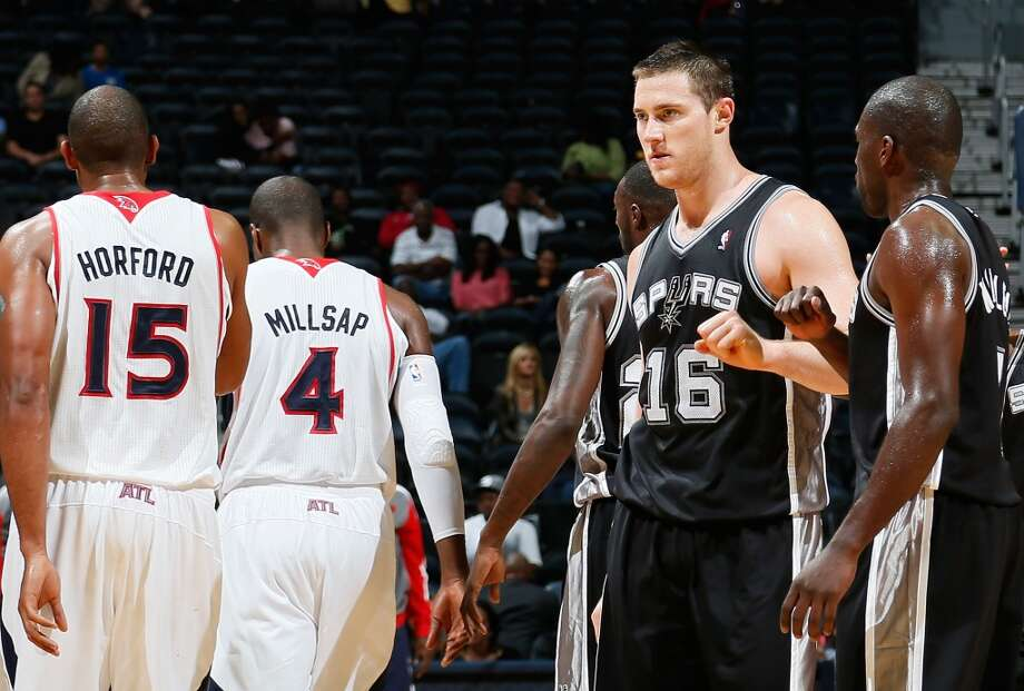 Aron Baynes #16 of the San Antonio Spurs reacts after hitting the go-ahead basket against the Atlanta Hawks with Dan Nwaelele #7 at Philips Arena on October 17, 2013 in Atlanta, Georgia. Photo: Kevin C. Cox, Getty Images
