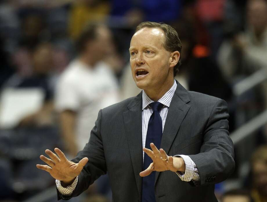 Atlanta Hawks head coach Mike Budenholzer coaches from the sideline during the first half of a preseason NBA basketball game against the San Antonio Spurs , Thursday, Oct. 17, 2013 in Atlanta. Photo: John Bazemore, Associated Press
