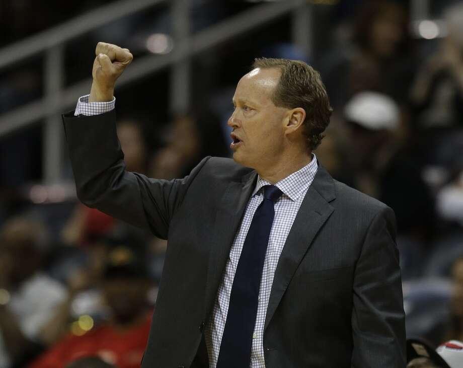 Atlanta Hawks head coach Mike Budenholzer is shown in the second half of a preseason NBA basketball game, Thursday, Oct. 17, 2013 in Atlanta.  San Antonio won 106-104. Photo: John Bazemore, Associated Press