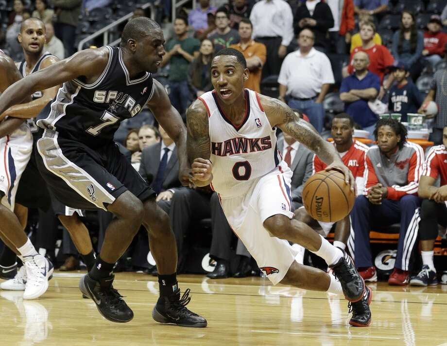 Atlanta Hawks point guard Jeff Teague (0) drives past San Antonio Spurs small forward Dan Nwaelele (7) in the second half of a preseason NBA basketball game, Thursday, Oct. 17, 2013 in Atlanta.  San Antonio won 106-104. Photo: John Bazemore, Associated Press