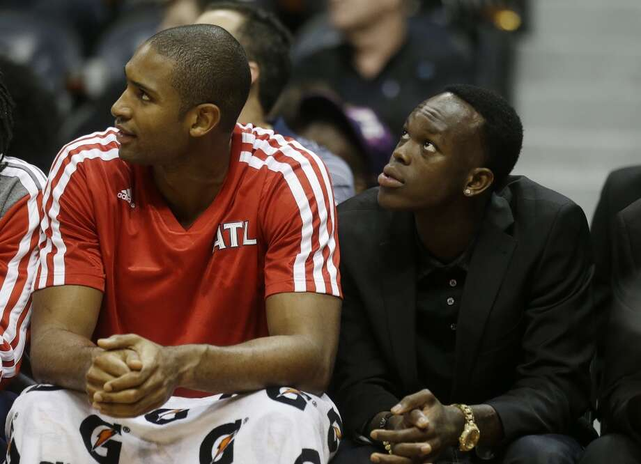 Atlanta Hawks point guard Dennis Schroder (17) sits next to teammate Al Horford, left, in the second half of a preseason NBA basketball game, Thursday, Oct. 17, 2013 in Atlanta.  San Antonio won 106-104. Photo: John Bazemore, Associated Press
