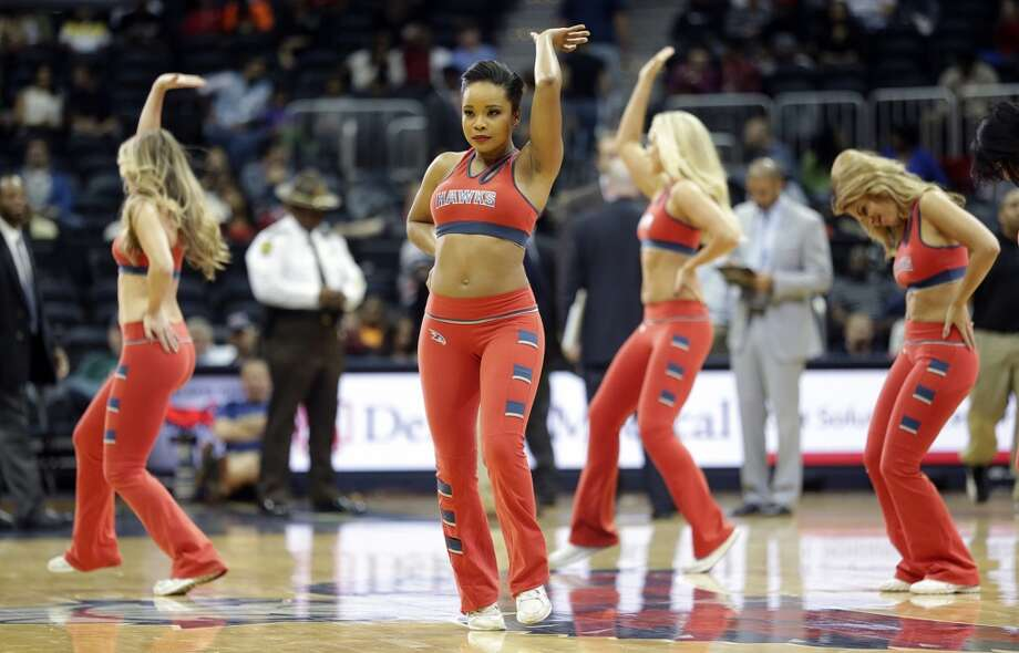 Atlanta Hawks cheerleader preform in the second half of a preseason NBA basketball game against the San Antonio Spurs , Thursday, Oct. 17, 2013 in Atlanta.  San Antonio won 106-104. (AP Photo/John Bazemore) Photo: Associated Press
