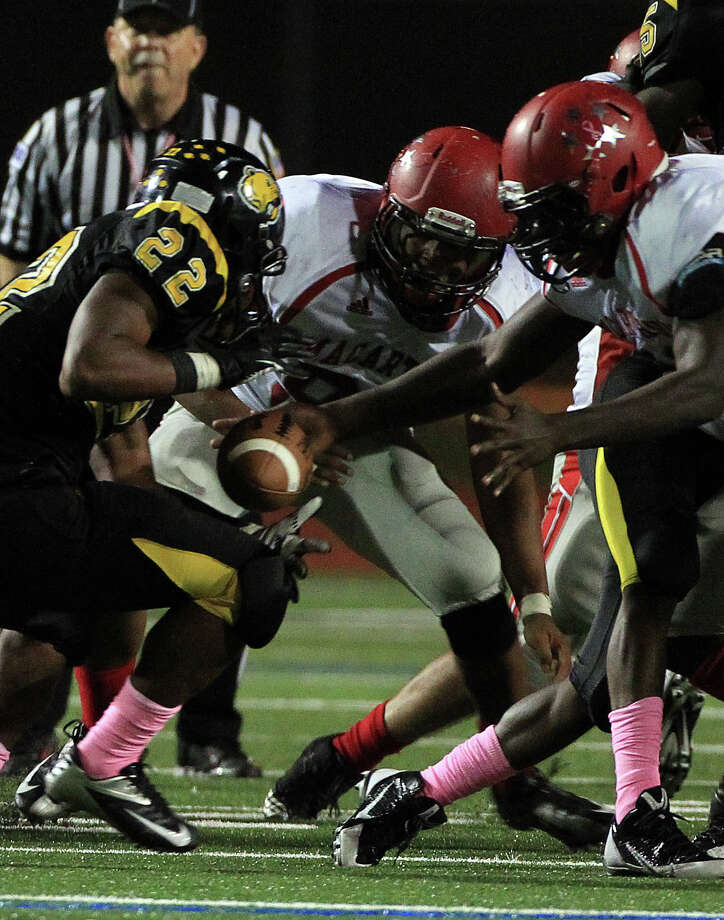 Hastings Fighting Bears (#22) Dondrei Williams looses possession of the ball during the football game against MacArthur High School at LeRoy Crump Stadium on Thursday, Oct. 17, 2013, in Houston.  MacArthur Generals won 21-0. Photo: Mayra Beltran, Houston Chronicle / © 2013 Houston Chronicle