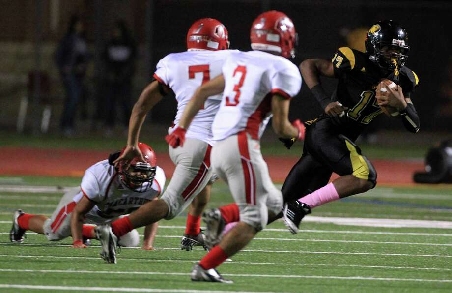 Hastings Fighting Bears (#17) Aubrey Brent gains yards during the football game against MacArthur High School at LeRoy Crump Stadium on Thursday, Oct. 17, 2013, in Houston.  MacArthur Generals won 21-0. Photo: Mayra Beltran, Houston Chronicle / © 2013 Houston Chronicle