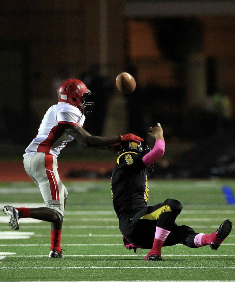 Aldine MacArthur Generals (#1) Steve Strahan chases Alief Hastings Fighting Bears (#8) Justin Gonzales who doesn't incomplete the pass in the first half of the football game at LeRoy Crump Stadium on Thursday, Oct. 17, 2013, in Houston. Photo: Mayra Beltran, Houston Chronicle / © 2013 Houston Chronicle