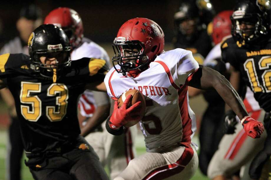 MacArthur's (#5) Derrick Ford gains yards against Hasting High School in the 2nd quarter of the football at LeRoy Crump Stadium on Thursday, Oct. 17, 2013, in Houston. Photo: Mayra Beltran, Houston Chronicle / © 2013 Houston Chronicle