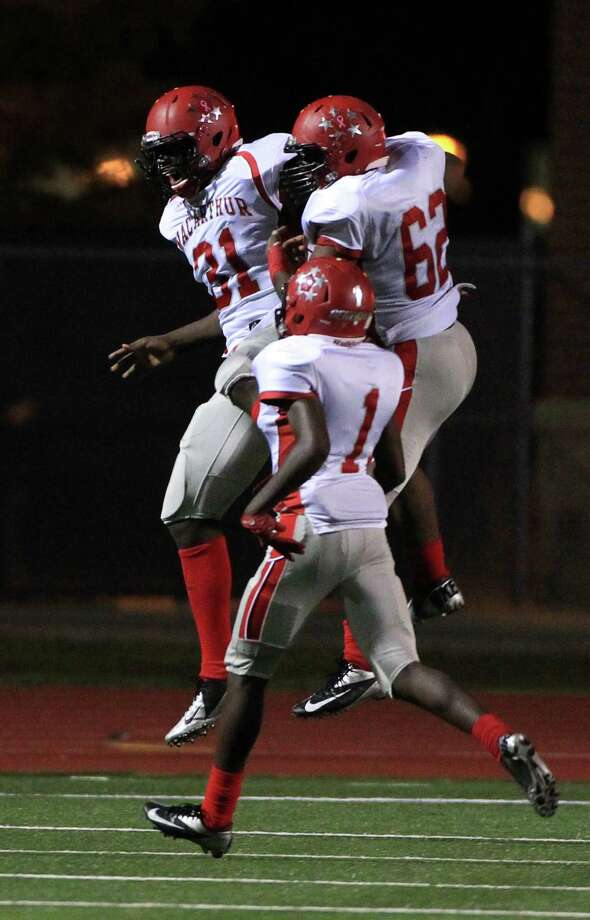 MacArthur's (#31) Isaiah Chambers celebrates a touchdown over Hastings at LeRoy Crump Stadium on Thursday, Oct. 17, 2013, in Houston.  MacArthur Generals won 21-0. Photo: Mayra Beltran, Houston Chronicle / © 2013 Houston Chronicle