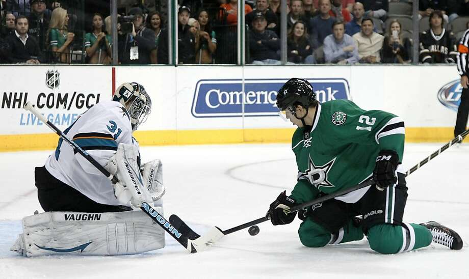 The Sharks' Antti Niemi defends the net against a shot attempt by Dallas rookie Alex Chiasson. Photo: Tony Gutierrez, Associated Press