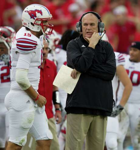 SMU coach June Jones, right, knows his stuff when it comes to quarterbacks. He correctly predicted in May that Case Keenum would impress the Texans this year. Photo: Smiley N. Pool, Staff / © 2011  Houston Chronicle