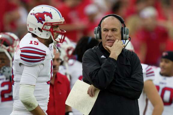 SMU coach June Jones, right, knows his stuff when it comes to quarterbacks. He correctly predicted in May that Case Keenum would impress the Texans this year.