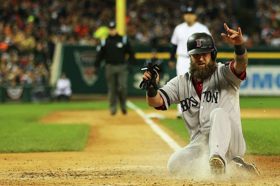 Mike Napoli was a catalyst for the Red Sox, who with Thursday's win at Detroit need just one more victory to advance to the World Series. Photo: Mike Ehrmann, Staff / 2013 Getty Images