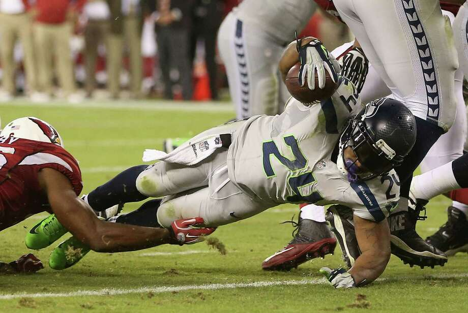 Marshawn Lynch's 91-yard rushing night is highlighted by a 2-yard touchdown plunge in the third quarter Thursday, helping the Seahawks to a 34-22 victory. Photo: Christian Petersen, Staff / 2013 Getty Images