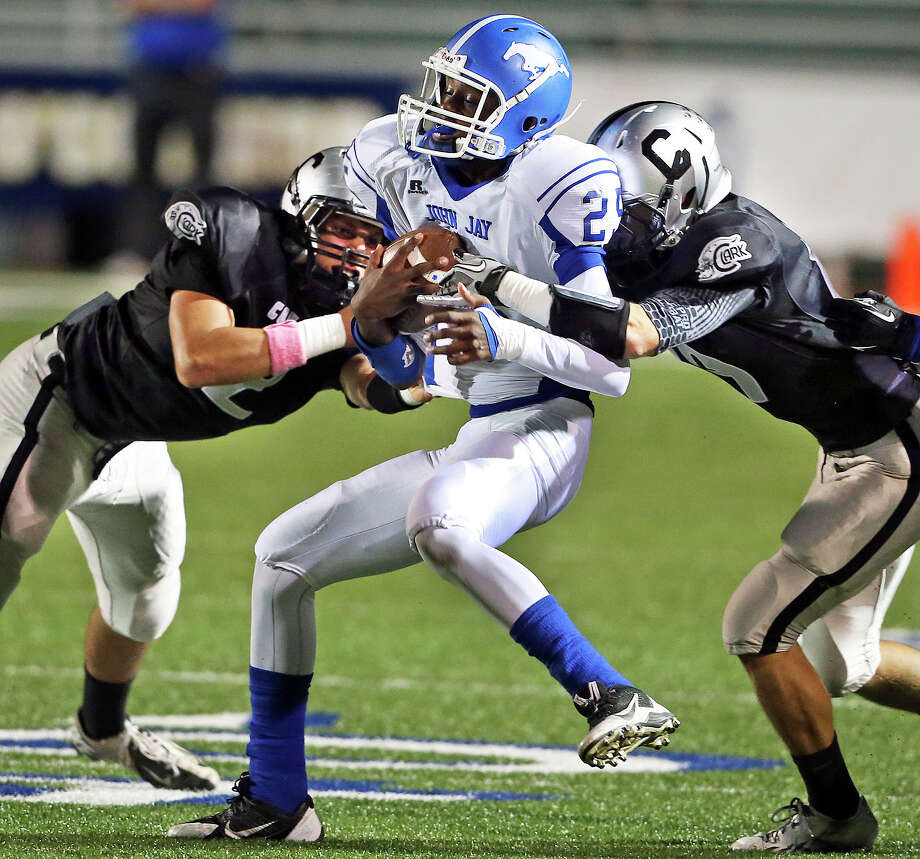 Mustang receiver Caleb Coleman-Lee is caught by Cougar defenders as Jay plays Clark at Farris Stadium on October 17, 2013. Photo: Tom Reel, San Antonio Express-News