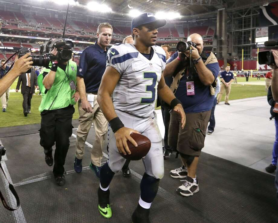 Player of the game Seattle Seahawks quarterback Russell Wilson (3) leave the field after an NFL football game against the Arizona Cardinals, Thursday, Oct. 17, 2013, in Glendale, Ariz. The Seahawks won 34-22. (AP Photo/Ross D. Franklin) Photo: AP