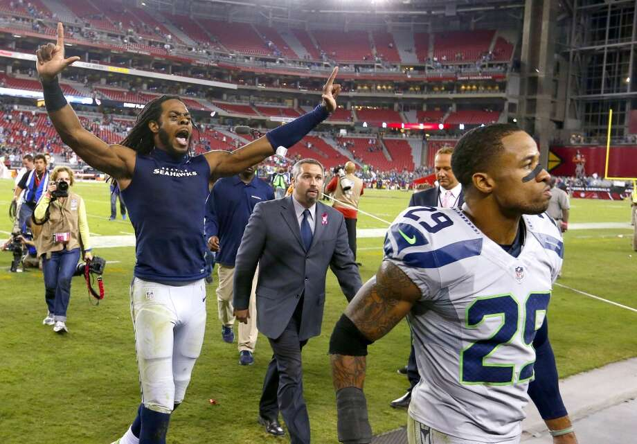 Seattle Seahawks' Richard Sherman, left, and Earl Thomas leave the field after an NFL football game victory against the Arizona Cardinals on Thursday Oct. 17, 2013, in Glendale, Ariz.  The Seahawks defeated the Cardinals 34-22. (AP Photo/Ross D. Franklin) Photo: AP