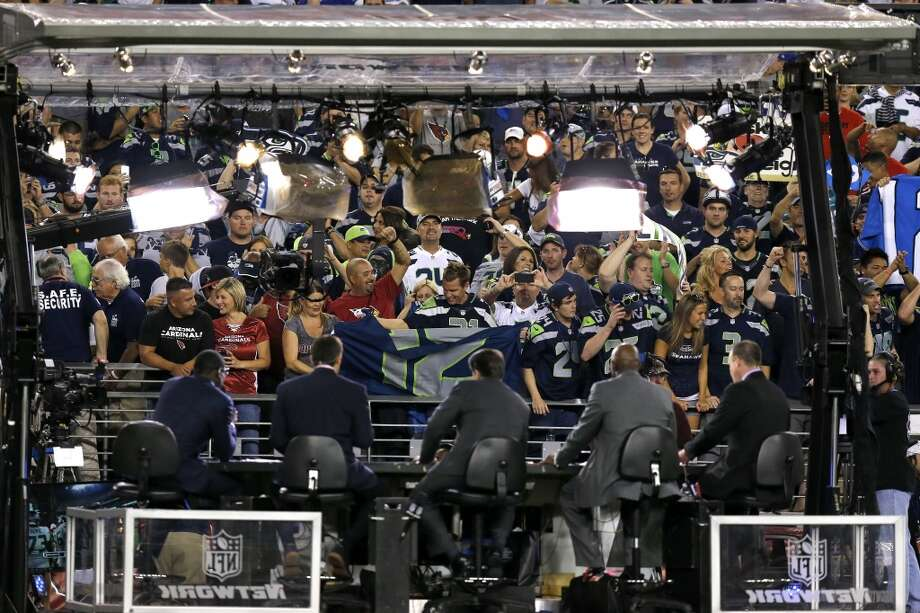 The NFL Network Thursday Night Football live crew performs after an NFL football game against the Arizona Cardinals and the Seattle Seahawks, Thursday, Oct. 17, 2013, in Glendale, Ariz. (AP Photo/Ross D. Franklin) Photo: AP