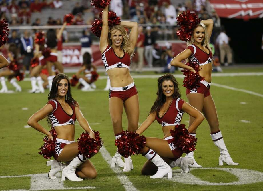 The Arizona Cardinals cheerleaders perform during the second half of an NFL football game against the Seattle Seahawks, Thursday, Oct. 17, 2013, in Glendale, Ariz. The Seahawks won 34-22. (AP Photo/Ross D. Franklin) Photo: AP