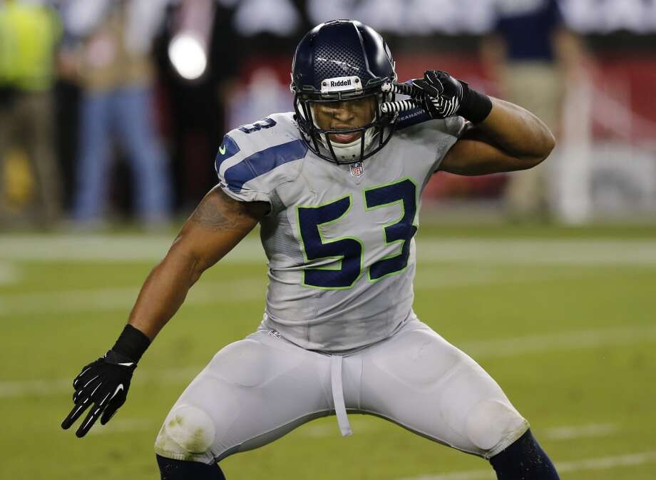 Seattle Seahawks outside linebacker Malcolm Smith (53) celebrates his sack on Arizona Cardinals' Carson Palmer during the second half of an NFL football game, Thursday, Oct. 17, 2013, in Glendale, Ariz. (AP Photo/Ross D. Franklin) Photo: AP