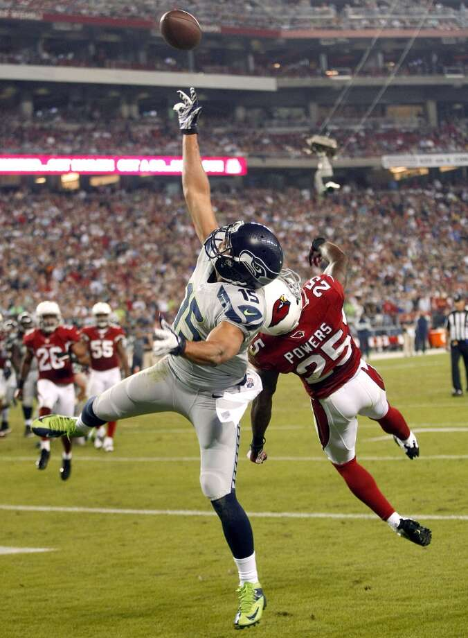 Seattle Seahawks wide receiver Jermaine Kearse (15) can't make the catch as Arizona Cardinals cornerback Jerraud Powers (25) defends during the second half of an NFL football game, Thursday, Oct. 17, 2013, in Glendale, Ariz. (AP Photo/Rick Scuteri) Photo: ASSOCIATED PRESS