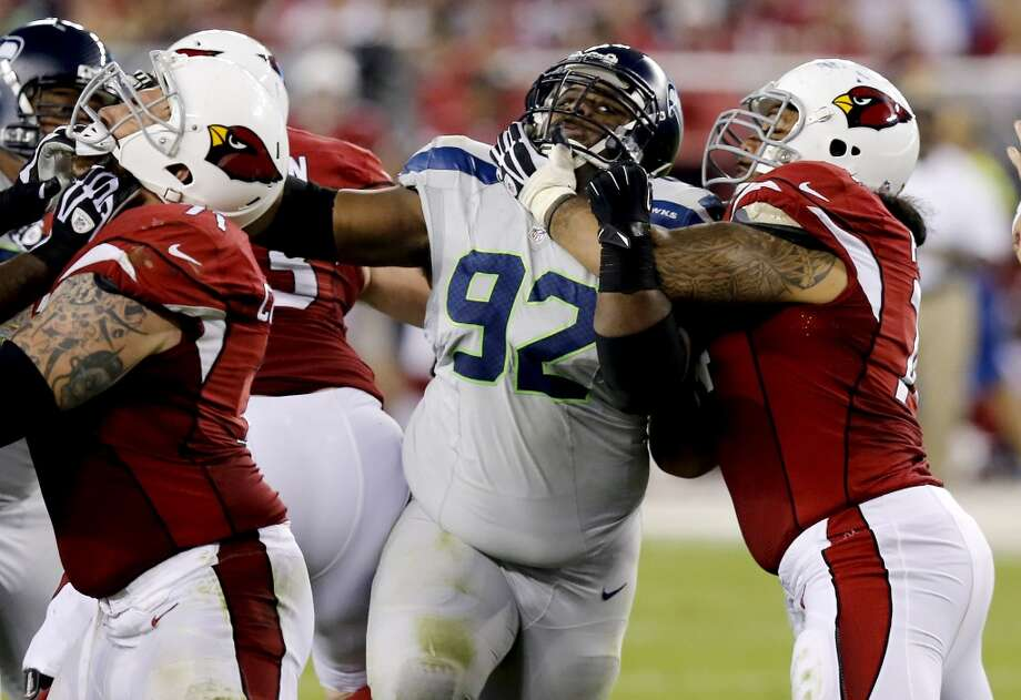 Seattle Seahawks defensive tackle Brandon Mebane (92) battles the Arizona Cardinals' line during the second half of an NFL football game, Thursday, Oct. 17, 2013, in Glendale, Ariz. (AP Photo/Ross D. Franklin) Photo: AP