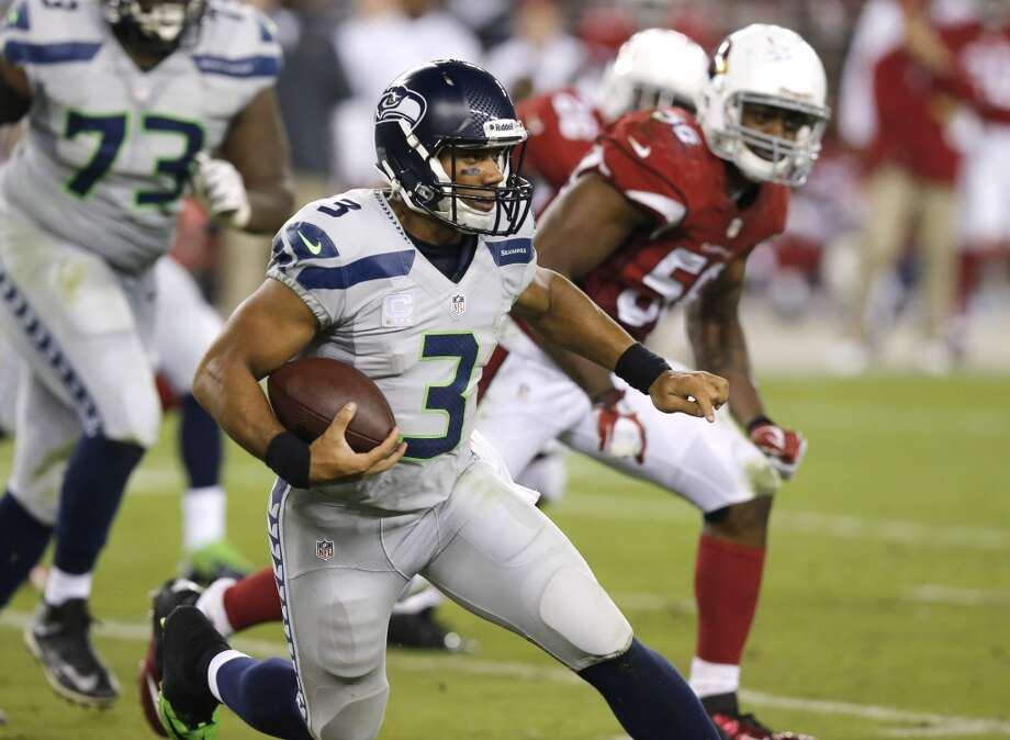 Seattle Seahawks quarterback Russell Wilson (3) runs against the Arizona Cardinals during the second half of an NFL football game, Thursday, Oct. 17, 2013, in Glendale, Ariz. (AP Photo/Ross D. Franklin) Photo: AP