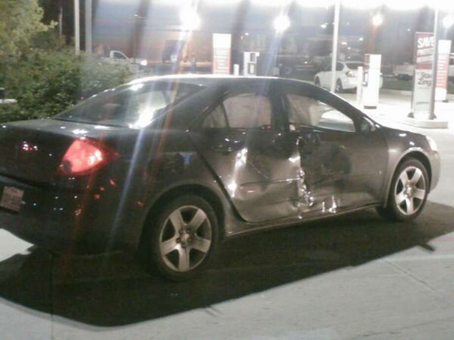 Reports indicate the motorcycle hit this vehicle. Photo: Mark D. Wilson/San Antonio Express-News