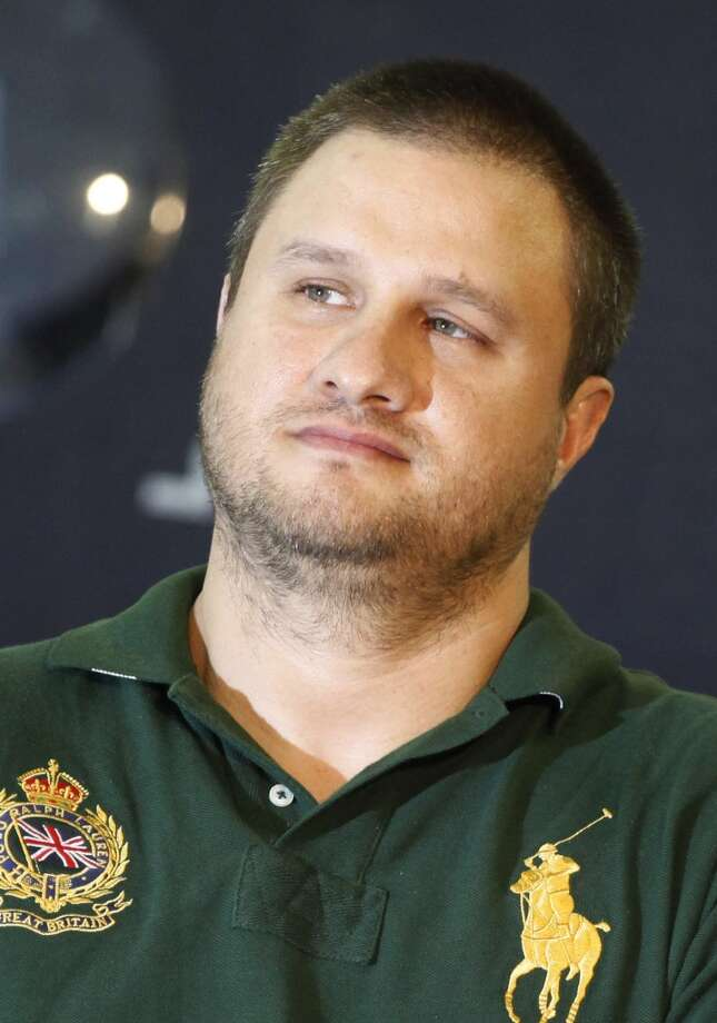 """Texas-born fugitive Edgar Valdez Villarreal, alias """"the Barbie,"""" center, is presented to the press in Mexico City, Tuesday Aug. 31, 2010.  Valdez, who was captured on Monday by federal police, faces drug trafficking charges in the U.S. and is blamed in Mexico for a brutal turf war that has included bodies hung from bridges, decapitations and shootouts as he and a rival fought for control of the divided Beltran Leyva cartel. Photo: Alexandre Meneghini, ASSOCIATED PRESS"""