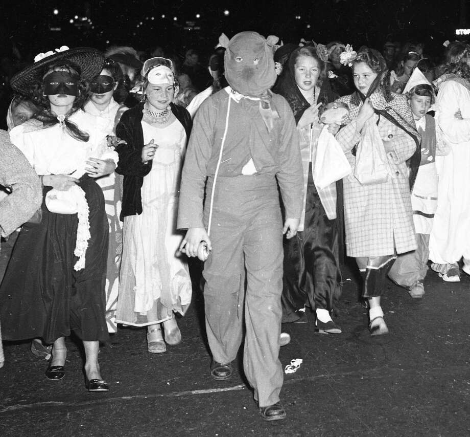 "Oct. 31, 1948: Another scary costume — pretty sure this inspired every horror movie from the past 65 years. These other kids wouldn't look so calm if ""Texas Chainsaw Massacre"" had come out by 1948. Photo: Chronicle Staff, The Chronicle"
