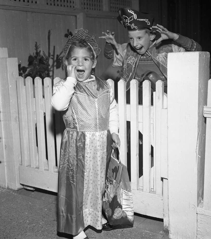 Oct. 31, 1958: Catherine Ternullo and Paul Grazioli celebrate Halloween. Catherine has one of the better costumes -- it looks home made. Photo: Bob Campbell, The Chronicle