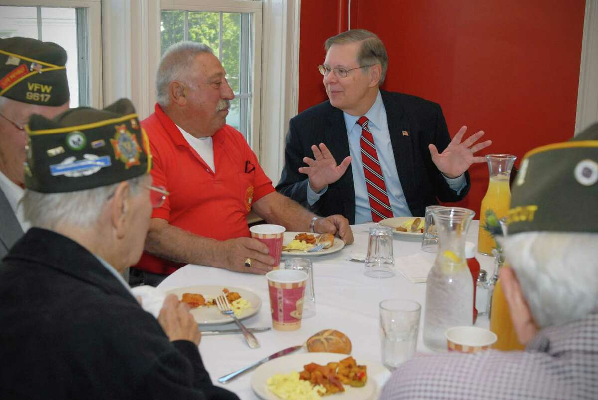 Pat Battinelli speaks with David Martin, the Democratic nominee for Mayor of Stamford, at a meet and greet breakfast with Stamford veterans on Friday October 18, 2013 at Zody's 19th Hole in Stamford, Conn.