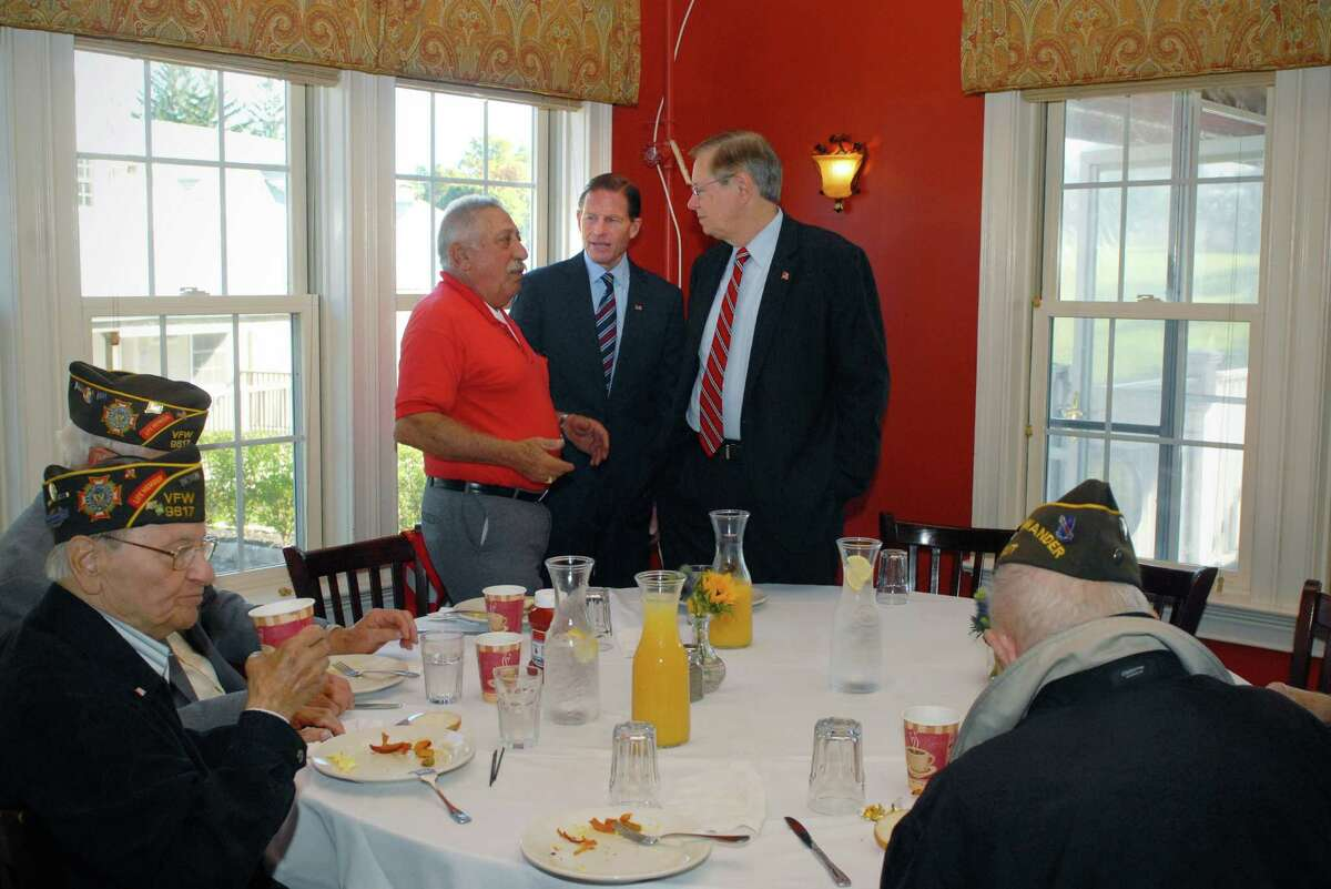 Pat Battinelli speaks with Senator Richard Blumenthal and David Martin, the Democratic nominee for Mayor of Stamford, at a meet and greet breakfast with Stamford veterans on Friday October 18, 2013 at Zody's 19th Hole in Stamford, Conn.