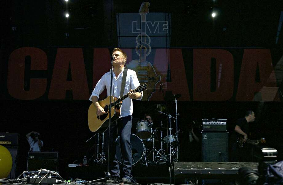 Bryan Adams performs during the Live 8 concert in Barrie, Ontario, Saturday July 2, 2005. The Live 8 concerts are part of a campaign to get the world's richest nations to cancel debt, increase aid to developing countries and promote fair trade. (AP Photo/Canadian Press, Aaron Harris) ORG XMIT: MER2013101811174494 Photo: AARON HARRIS / CP