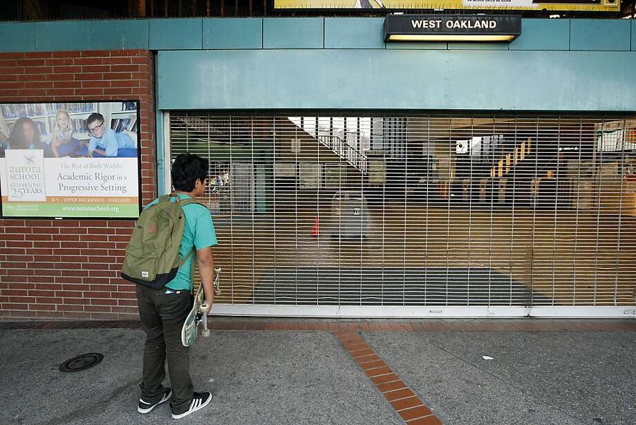Isaac Santos, trying to get to school in Berkeley, didn't know about the strike when he arrived at the West Oakland Station. Photo: Michael Short, The Chronicle