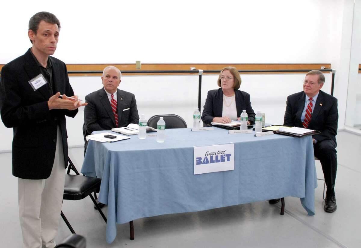 Connecticut Ballet artistic director Brett Raphael moderates a mayoral debate with Michael Fedele (R), Kathleen Murphy (I) and David Martin (D) on the arts on Friday, October 18, 2013 in Stamford, Conn.