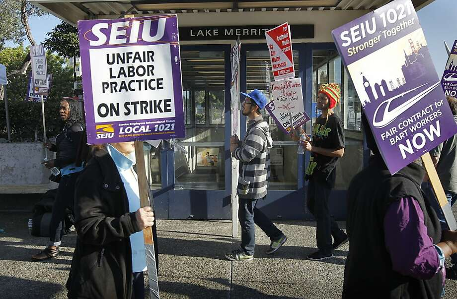 A picket line forms in front of the BART Lake Merritt station in Oakland, Calif. on Friday Oct. 18, 2012. After contract talks broke down between BART management and unions, workers went on strike at 12 am Friday morning and BART service has come to a stop system wide. Photo: Michael Macor, The Chronicle